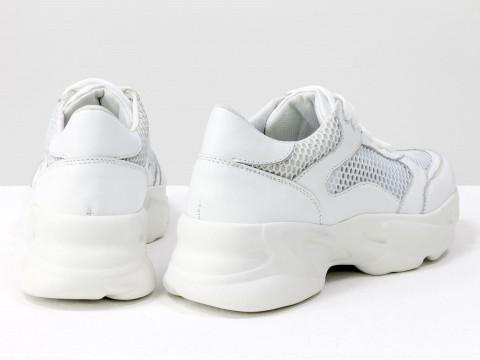 Женские кроссовки дыщащие из натуральной кожи белого  цвета на современной подошве
