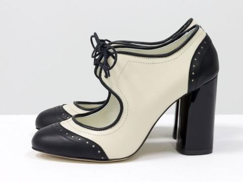 Туфли на высоком каблуке из натуральной кожи молочного и черного цвета