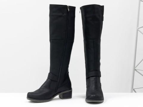 Женские сапожки из матовой кожи черного цвета на не высоком устойчивом каблуке