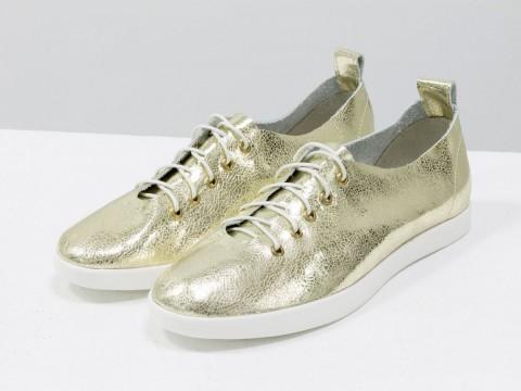 Женские спортивные туфли золотого цвета со шнуровкой
