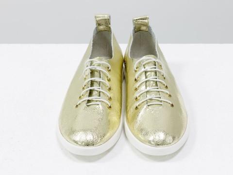 Женские спортивные туфли из натуральной кожи золотого цвета на шнуровке