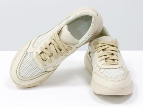 Женские кроссовки из натуральной кожи бежевого цвета на современной подошве